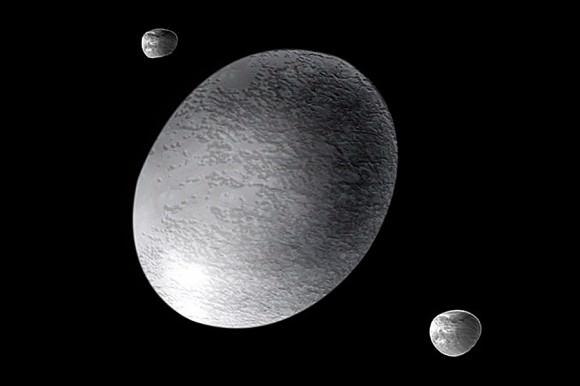 Artist's impression of the dwarf planet Haumea and its moons, Hi'aka and Namaka. Credit: NASA