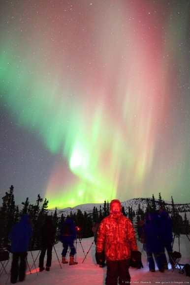John Chumack stand under the Aurora Borealis near Fairbanks, Alaska on March 25, 2014. Credit and copyright: John Chumack.