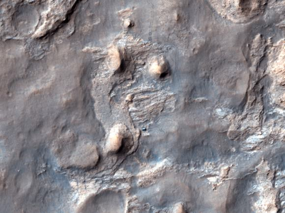 "A recent image taken by the HiRISE camera on the Mars Reconnaissance Orbiter of the Curiosity rover in ""The Kimberly"" area in Gale Crater on Mars. Credit: NASA/JPL/University of Arizona"