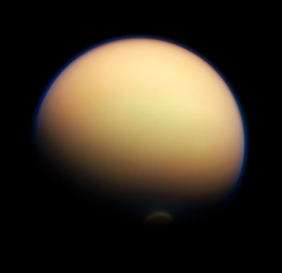 Titan's surface is almost completely hidden from view by its thick orange