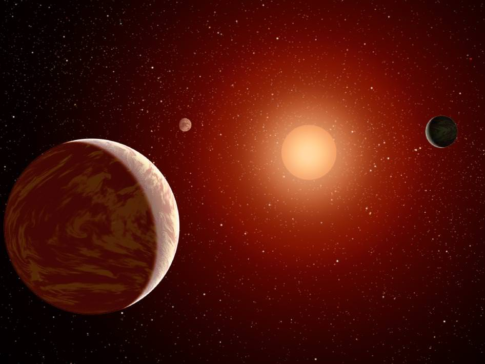 An artist's conception of a red dwarf solar system. Red dwarfs can produce a lot of flaring activity, which is problematic for the habitability of their planets. Credit: NASA/JPL-Caltech.