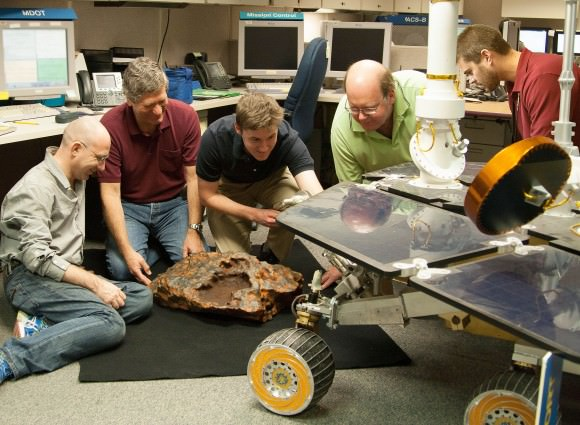 Researcher Kris Capraro (second from left) adds the finishing touches of realistic color to a model of the