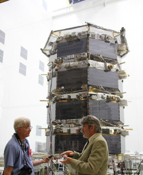 MMS Project Manager Craig Tooley (right) and Ken Kremer (Universe Today) discuss  science objectives of NASA's upcoming Magnetospheric Multiscale mission by 20 foot tall mated quartet of stacked spacecraft at the cleanroom at NASA's Goddard Space Flight Center in Greenbelt, Md., on May 12, 2014.  Credit: Ken Kremer- kenkremer.com