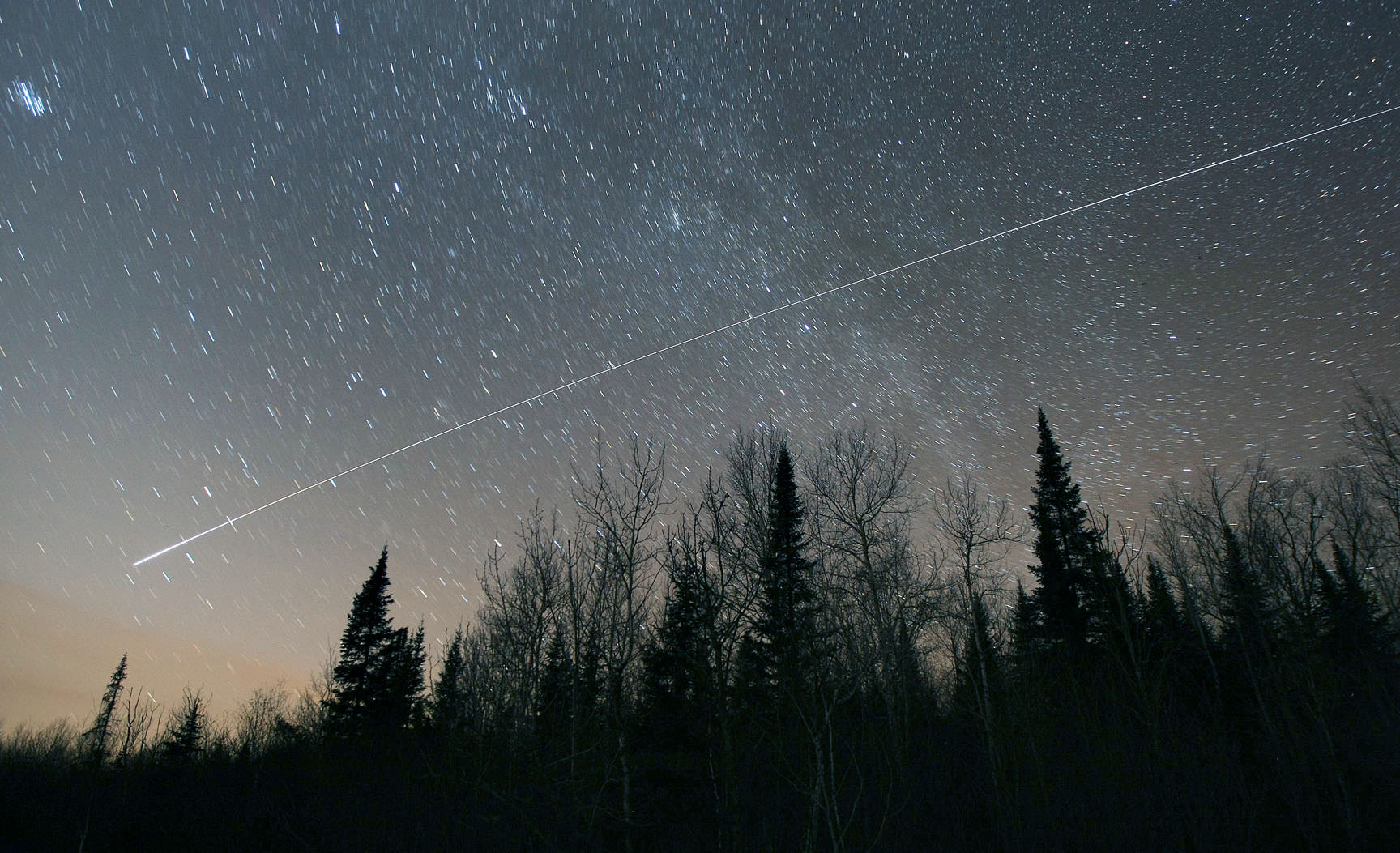 Time exposure showing the International Space Station making a bright pass across the northern sky. Credit: Bob King