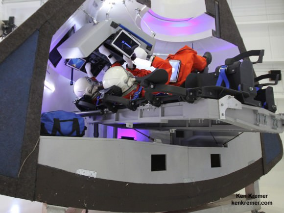Boeing's commercial CST-100 'Space Taxi' will carry a crew of five astronauts to low Earth orbit and the ISS from US soil.   Mockup with astronaut mannequins seated below pilot console and Samsung tablets was unveiled on June 9, 2014 at its planned manufacturing facility at the Kennedy Space Center in Florida.  Credit: Ken Kremer - kenkremer.com
