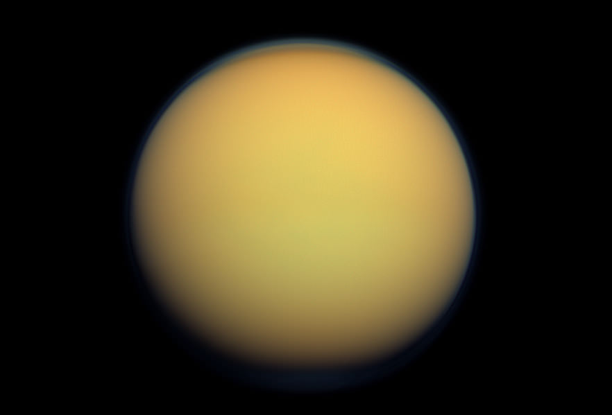 Titan's atmosphere makes Saturn's largest moon look like a fuzzy orange ball in this natural-color view from the Cassini spacecraft. Cassini captured this image in 2012. Image Credit: NASA/JPL-Caltech/Space Science Institute