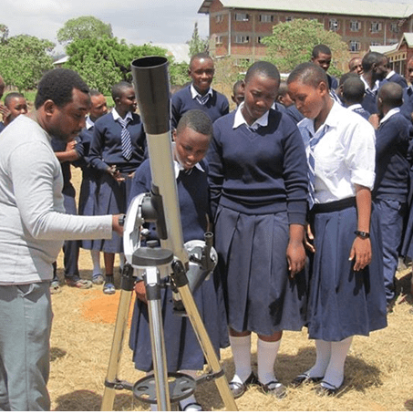 Mponda Malazo from  Tanzania who works with Astronomers Without Borders, teaches students about solar dynamics. Another solar viewing telescope with a sun-funnel will be on its way to Tanzania soon. Credit: Astronomers Without Borders.