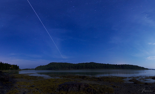 The International Space Station (ISS) makes a 71º maximum elevation pass over the Little Kennebec Bay, in Roque Bluffs, Maine. The photo is a five-frame vertical panorama with the ISS's path composited. Credit and copyright: David Murr.