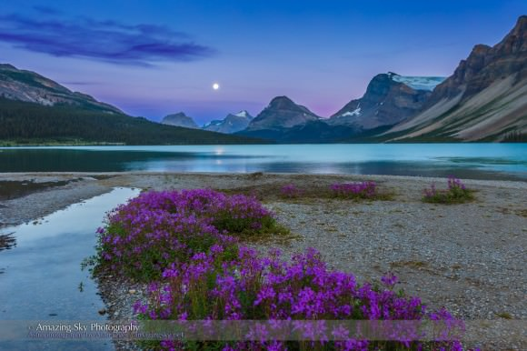 A nearly full supermoon rises above Bow Lake, British Columbia. Credit: Alan Dyer
