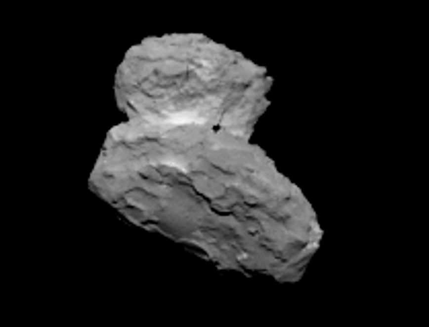 Comet 67P/Churyumov-Gerasimenko at 621 miles (1,000 km) on August 1. Wow! Look at that richly-textured surface. This photo has higher resolution than previous images because it was taken with Rosetta's narrow angle camera. The black spot is an artifact. Credit: ESA/Rosetta/MPS for OSIRIS Team MPS/UPD/LAM/IAA/SSO/INTA/UPM/DASP/IDA