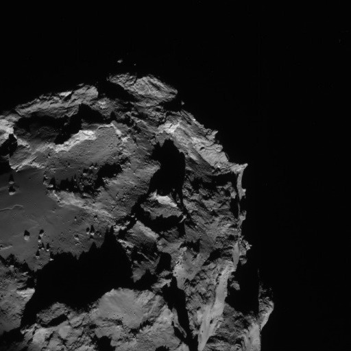 The Rosetta navigation camera sent back this image of Comet 67P/Churyumov-Gerasimenko on August 23, showing about a quarter of the four-kilometer (2.5-mile) comet. This image was acquired from a distance of 61 kilometers (38 miles). Credit: ESA/Rosetta/NAVCAM
