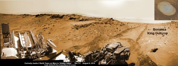 NASA's Curiosity rover looks back to ramp with potential 4th drill site target at 'Bonanza King' rock outcrop in 'Hidden Valley' in this photo mosaic view captured on Aug. 6, 2014, Sol 711.  Inset shows results of brushing on Aug. 17, Sol 722, that revealed gray patch beneath red dust.  Note the rover's partial selfie, valley walls, deep wheel tracks in the sand dunes and distant rim of Gale crater beyond the ramp. Navcam camera raw images stitched and colorized.  Credit: NASA/JPL-Caltech/Ken Kremer-kenkremer.com/Marco Di Lorenzo