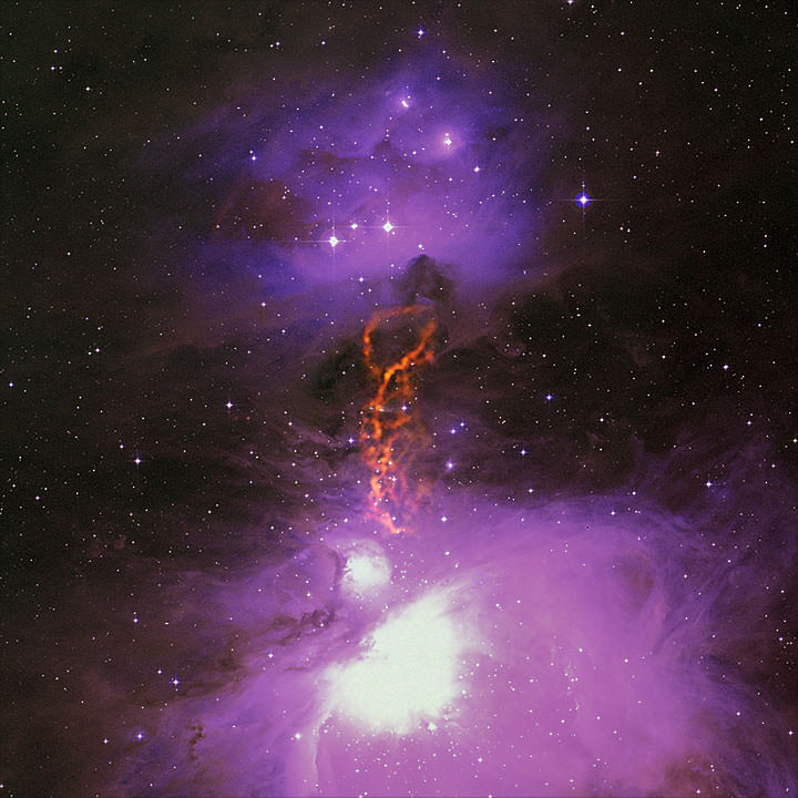 Radio/optical composite of the Orion Molecular Cloud Complex showing the OMC-2/3 star-forming filament. GBT data is shown in orange. Uncommonly large dust grains there may kick-start planet formation. Credit: S. Schnee, et al.; B. Saxton, B. Kent (NRAO/AUI/NSF); We acknowledge the use of NASA's SkyView Facility located at NASA Goddard Space Flight Center.