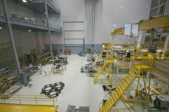 JWST is being assembled here inside the world's largest clean room at NASA Goddard Space Flight Center, Greenbelt, Md. Primary mirror segments stored in silver colored containers at top left. Technicians practice mirror installation on test piece of backplane (known as the BSTA or Backplane Stability Test Article) at center, 3 hexagonals.  Telescope assembly bays at right.  Credit: Ken Kremer- kenkremer.com