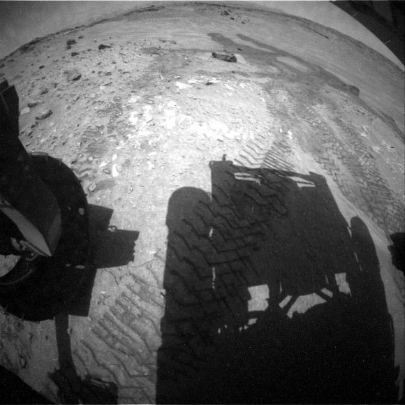 A shadow of Mars Curiosity lies across the surface in this picture taken Aug. 9, 2014. Credit: NASA/JPL-Caltech