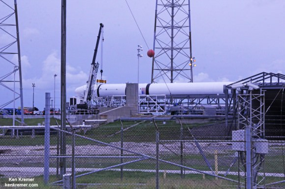 SpaceX Falcon 9  rests horizontally at Cape Canaveral launch pad 40 awaiting blastoff reset to Sept 21, 2014 on the CRS-4 mission.  Credit: Ken Kremer - kenkremer.com