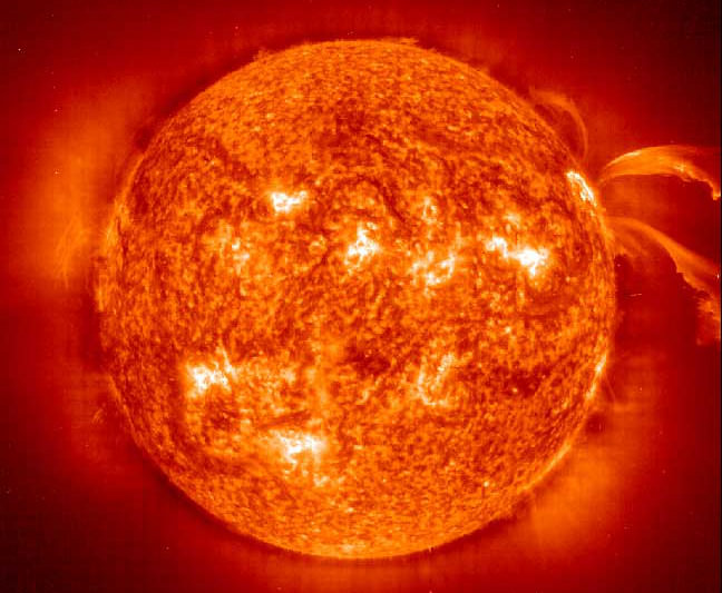This image from the Solar and Heliospheric Observatory (SOHO) Extreme ultraviolet Imaging Telescope (EIT) image shows large magnetically active regions and a pair of curving erupting prominences on June 28, 2000 during the current solar cycle 23 maximum. Prominences are huge clouds of relatively cool dense plasma suspended in the Sun's hot, thin corona. Magnetically active regions cause the principal total solar irradiance variations during each solar cycle. The hottest areas appear almost white, while the darker red areas indicate cooler temperatures. Credit: NASA & European Space Agency (ESA)