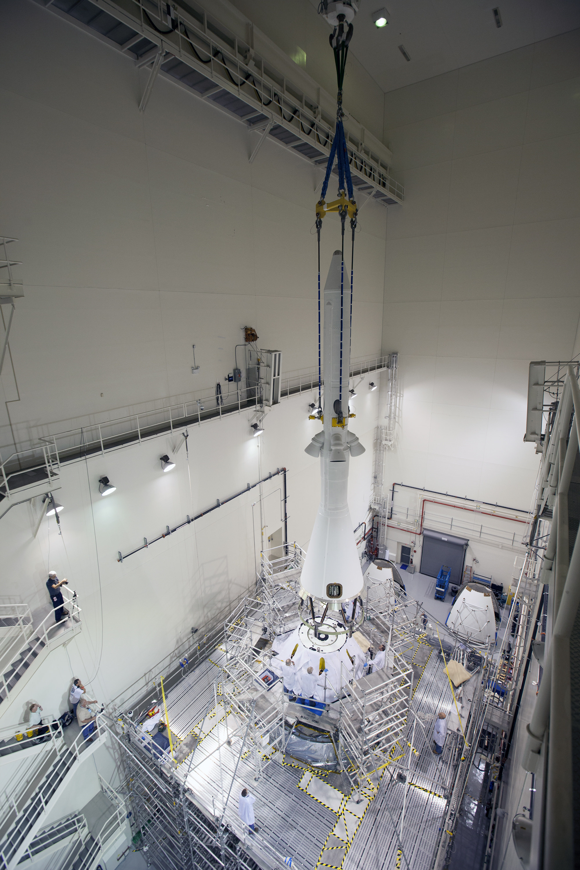 The launch abort system is lowered by crane for installation on the Orion spacecraft for Exploration Flight Test-1 inside the Launch Abort System Facility, or LASF, at NASA's Kennedy Space Center in Florida.   Photo credit: NASA/Cory Huston