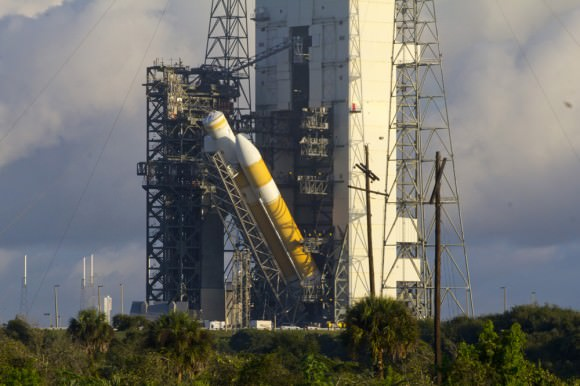 ULA Delta IV Heavy rocket launching NASA's Orion's EFT-1 in Dec. 2014 being hoisted vertical at SLC-37B on the morning of Oct. 1, 2014. Credit: Jeff Seibert/Wired4Space