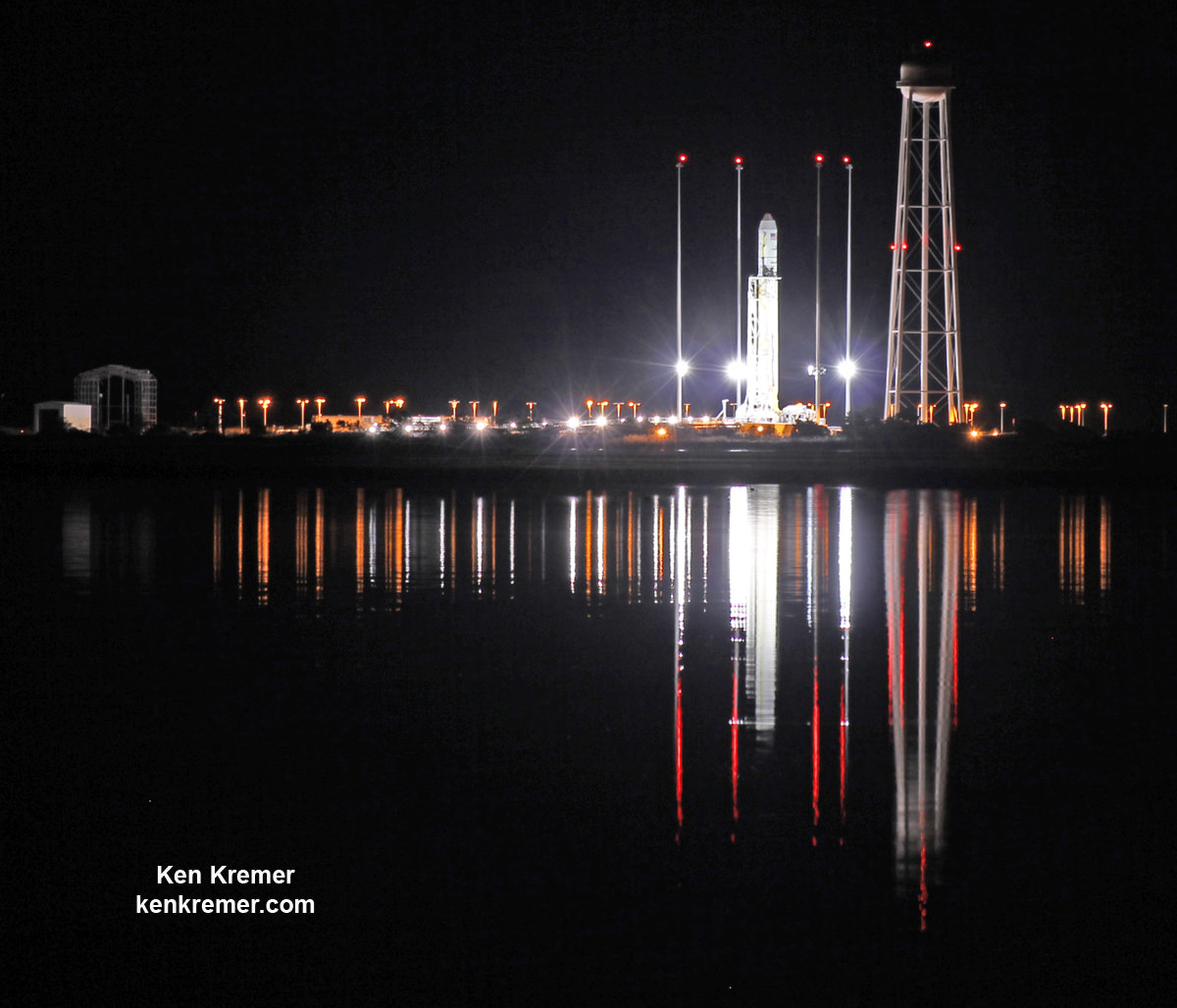 Antares rocket stands erect, reflecting off the calm waters the night before the first night launch from NASA's Wallops Flight Facility, VA, on Oct. 28, 2014.    Credit: Ken Kremer/kenkremer.com