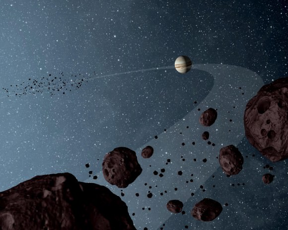 Artist's diagram of Jupiter and some Trojan asteroids nearby the gas giant. Credit: NASA/JPL-Caltech