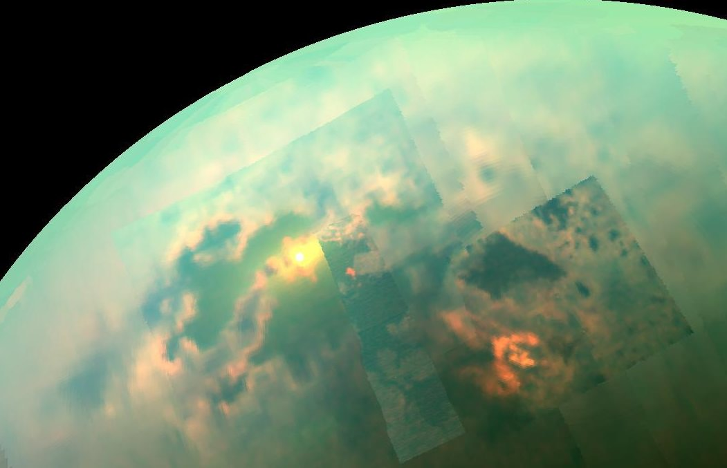 In this near-infrared mosaic, the sun shines off of the seas on Saturn's moon, Titan. Credit: NASA/JPL-Caltech/University of Arizona/University of Idaho
