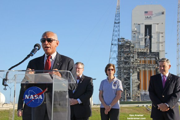NASA Administrator Charles Bolden briefs the media about the 'Big Deal' goals of the first Orion deep space crew module during prelaunch meeting backdropped by Orion and Delta 4 Heavy Booster at Space Launch Complex 37 (SLC-37) at Cape Canaveral Air Force Station in Florida prior to launch on Dec. 5, 2014.   Credit: Ken Kremer - kenkremer.com