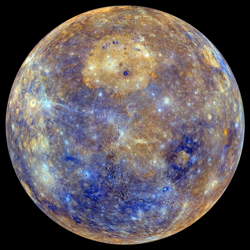 Caloris in Color – An enhanced-color view of Mercury, assembled from images taken at various wavelengths by the cameras on board the MESSENGER spacecraft. The circular, orange area near the center-top of the disc is Caloris Basin. Apollodorus and Pantheon Fossae can be seen at the center-left of the basin. Credit: NASA / Johns Hopkins University Applied Physics Laboratory / Carnegie Institution of Washington