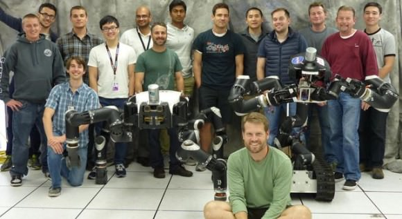 Robotics researchers at NASA's Jet Propulsion Laboratory in Pasadena, California, stand with robots RoboSimian and Surrogate, both built at JPL. Credit: JPL-Caltech