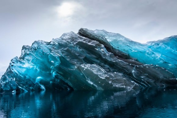 This stunning glacial portrait was photographed in Cierva Cove, Antarctica. An incredibly rare sight--this photo reveals the beautiful colors and pure surface of the underside of an iceberg. Credit and copyright: Alex Cornell.