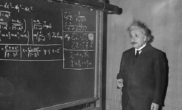 Prof. Albert Einstein uses the blackboard as he delivers the 11th Josiah Willard Gibbs lecture at the meeting of the American Association for the Advancement of Science in the auditorium of the Carnegie Institue of Technology Little Theater at Pittsburgh, Pa., on Dec. 28, 1934. Using three symbols, for matter, energy and the speed of light respectively, Einstein offers additional proof of a theorem propounded by him in 1905 that matter and energy are the same thing in different forms. (AP Photo)