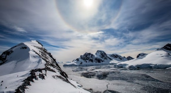 A Sun halo seen among the the landscape and ice flows of Antarctica. Credit and copyright: Alex Cornell.