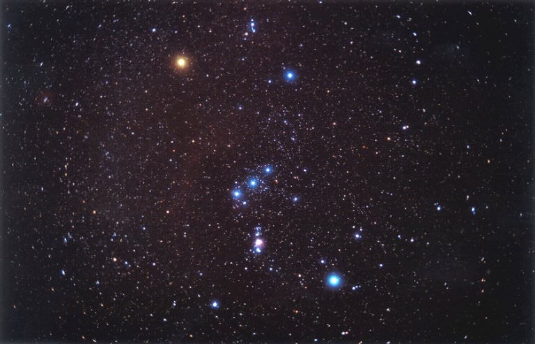 The familiar constellation of Orion. Orion's Belt can be clearly seen, as well as Betelgeuse (red star in the upper left corner) and Rigel (bright blue star in the lower right corner) Credit: NASA Astronomy Picture of the Day Collection NASA.