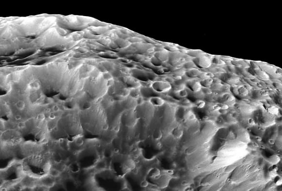 Impactors tend to make craters by compressing the surface material, rather than blasting it out. (NASA/JPL/SSI. Edit by J. Major.)
