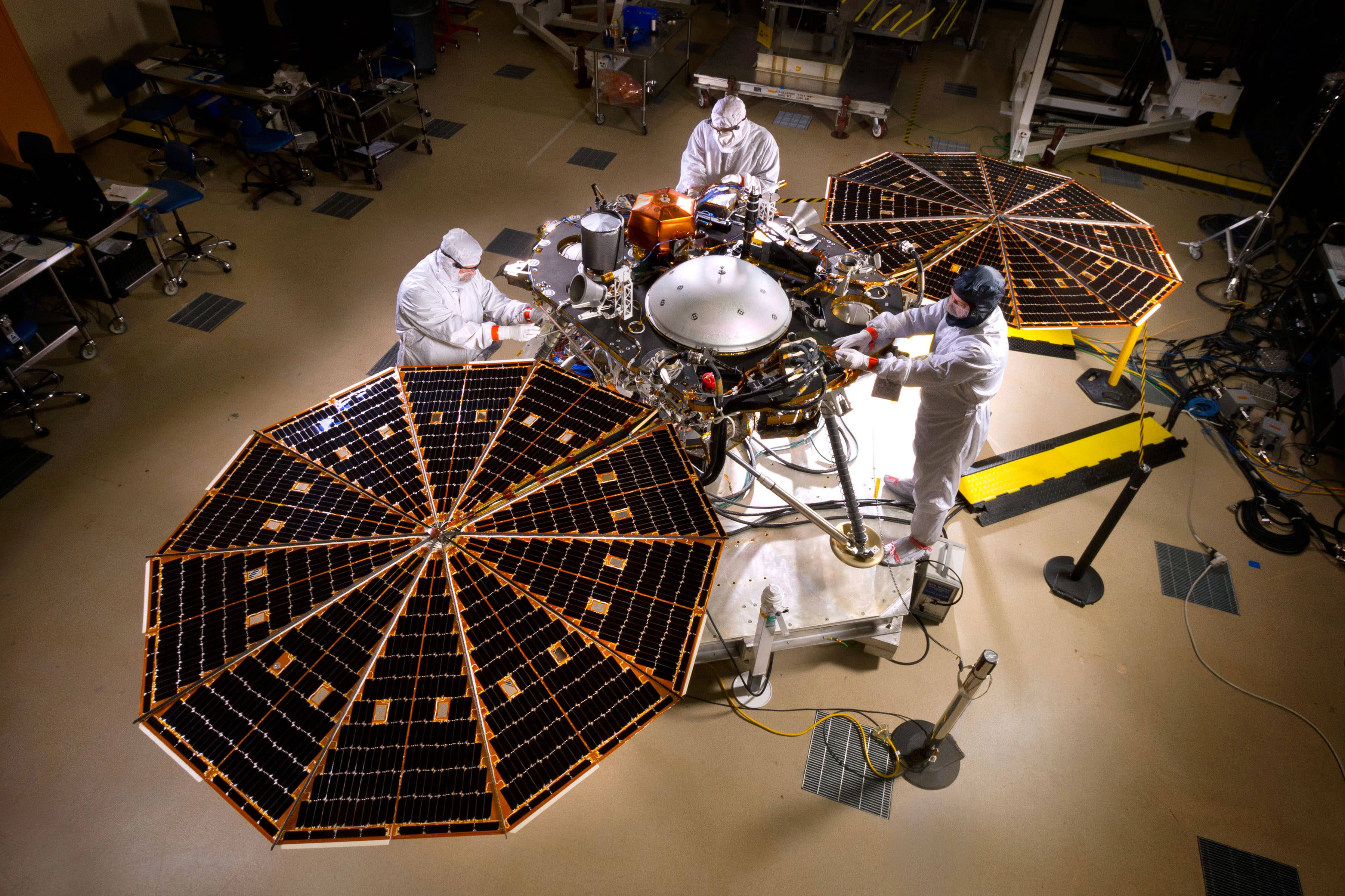 NASA's InSight Mars lander spacecraft in a Lockheed Martin clean room near Denver. As part of a series of deployment tests, the spacecraft was commanded to deploy its solar arrays in the clean room to test and verify the exact process that it will use on the surface of Mars.  Credits: NASA/JPL-Caltech/Lockheed Martin