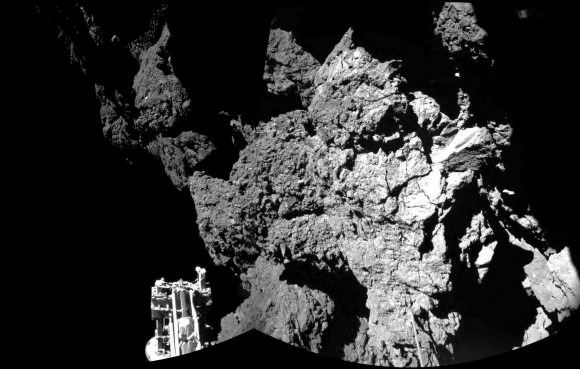 First image taken by Philae after landing on the comet on November 12, 2015. It shows a steep cliff and one of the  lander's legs. Credit: ESA/ROSETTA/PHILAE/CIVA