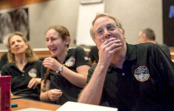 Members of NASA's New Horizons team react to seeing the latest image of Pluto. Credit: NASA