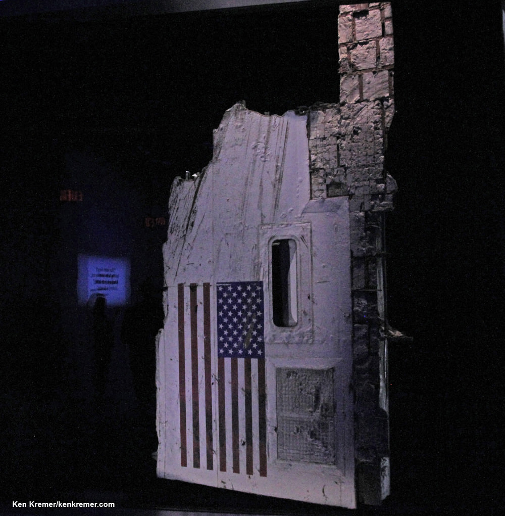 "Up close view of the iconic section of the fuselage recovered from space shuttle Challenger with the American flag now on permanent display in the newly opened ""Forever Remembered"" public memorial tribute located in the Space Shuttle Atlantis exhibit at the Kennedy Space Center Visitor Complex in Florida.  Credit: Ken Kremer/kenkremer.com"
