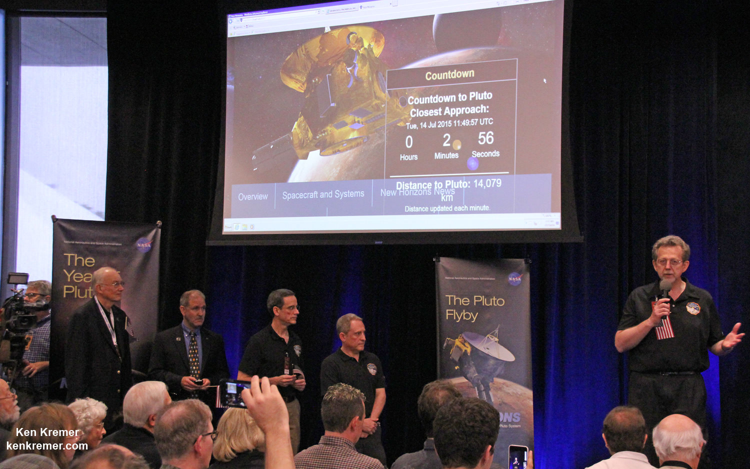 Counting down to less than 3 minutes from New Horizons closest approach to Pluto, Jim Green, NASA Planetary Science Division Director, addresses the team, guests and media on Tuesday, July 14, 2015 at the Johns Hopkins University Applied Physics Laboratory (APL) in Laurel, Maryland. Credit: Ken Kremer/kenkremer.com
