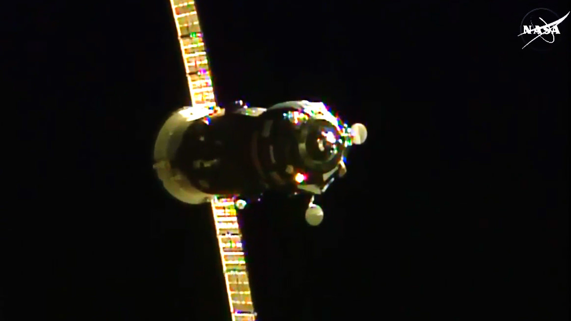 The ISS Progress 60 cargo craft is seen just a few minutes away from docking to the International Space Station. Credit: NASA TV