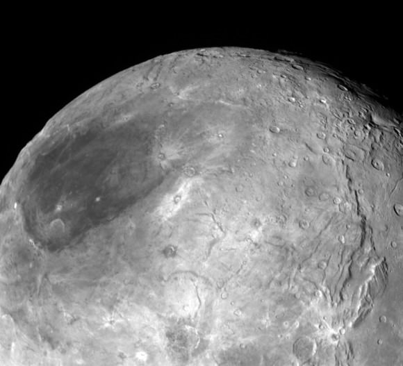 Looking over Charon's dark north polar region, the border of which is highlighted by several beautiful rayed craters. Not that it's necessarily related, but the dark spot reminds me of a lunar mare or sea. On the moon, cracks in the crust allowed lava to fill gigantic basins to create the maria. Could material from beneath Charon have bubbled up to fill an ancient impact? Credit: NASA/Johns Hopkins University Applied Physics Laboratory/Southwest Research Institute