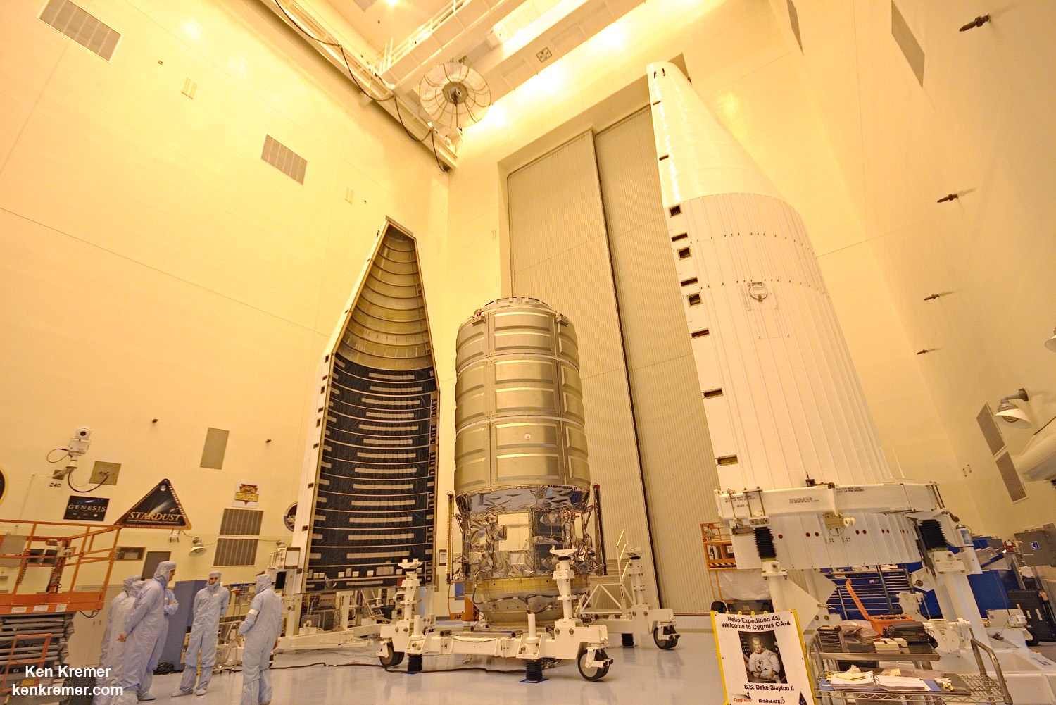 First enhanced Orbital ATK Cygnus commercial cargo ship is fully assembled and being processed for blastoff  to the ISS on Dec. 3, 2015 on an ULA Atlas V rocket. This view shows the Cygnus, named the SS Deke Slayton II, and twin payload enclosure fairings inside the Kennedy Space Center clean room.   Credit: Ken Kremer/kenkremer.com