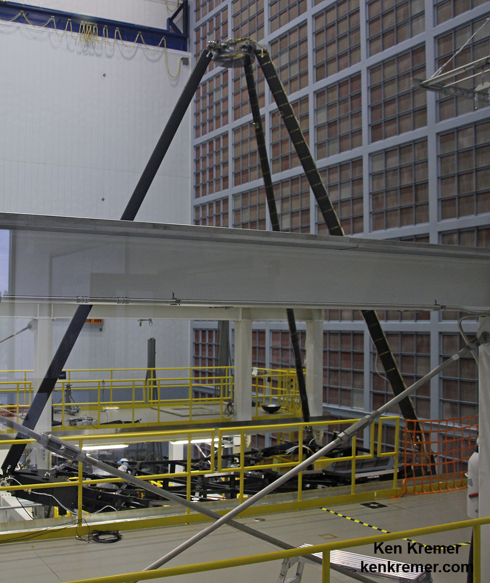 "Engineers practiced mirror installation techniques and processing using a spare primary mirror on JWST's ""Pathfinder"" backplane and secondary mirror tripod assembly in 2014 inside the clean room at NASA Goddard Space Flight Center, Greenbelt, Md.  Secondary mirror at top.  Credit: Ken Kremer/ kenkremer.com"