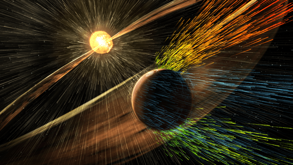 Artist's rendering of a solar storm hitting Mars and stripping ions from the planet's upper atmosphere.  Credits: NASA/GSFC