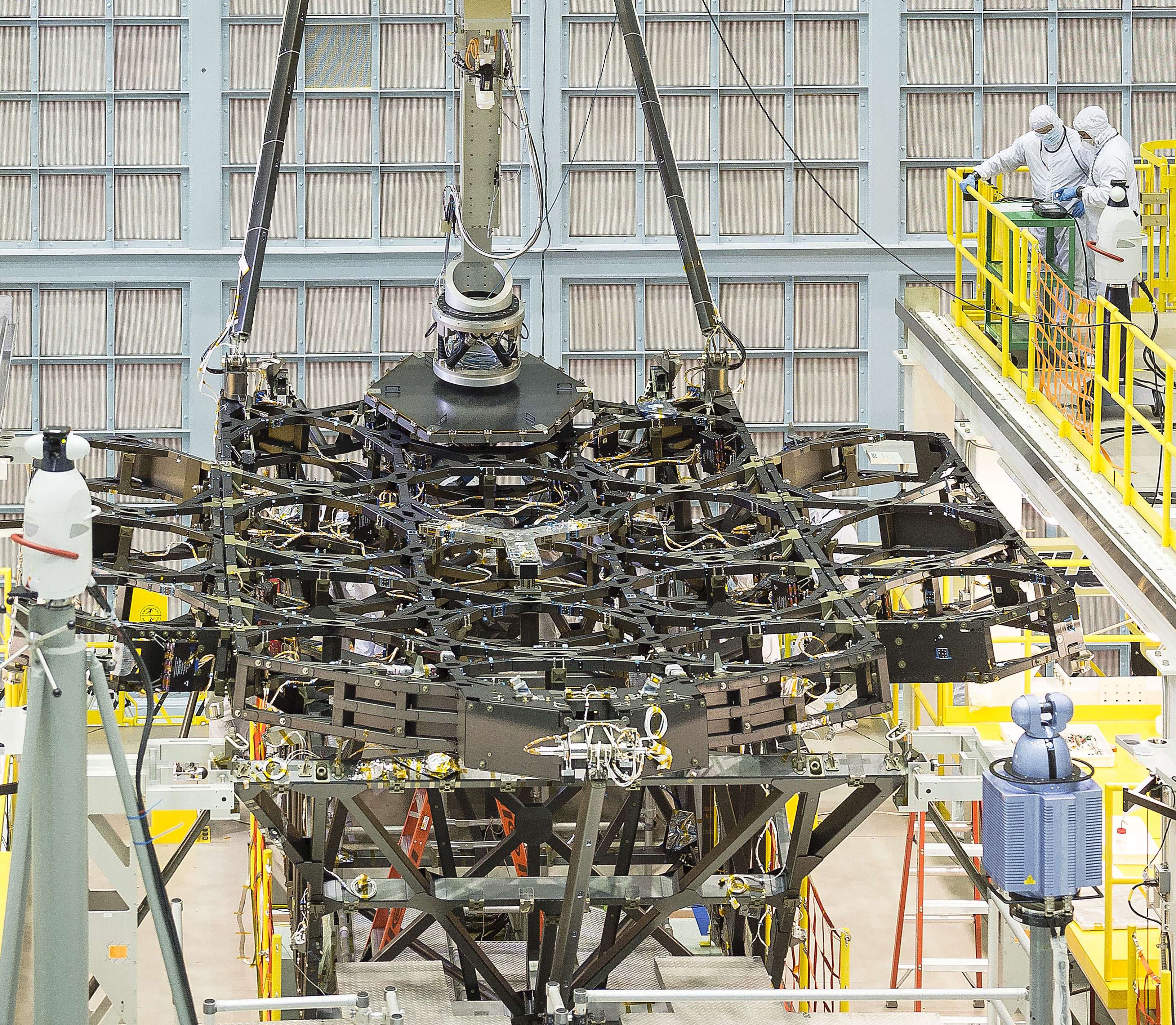 The James Webb Space Telescope team successfully installed the first flight mirror onto the telescope structure at NASA's Goddard Space Flight Center in Greenbelt, Maryland.  Credits: NASA/Chris Gunn