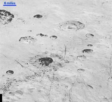 Layered Craters and Icy Plains: Pluto's rugged, icy cratered plains include layering in the interior walls of many craters. Layers in geology usually mean an important change in composition or event, but at the moment New Horizons team members do not know if they are seeing local, regional or global layering. Credit: NASA/Johns Hopkins University Applied Physics Laboratory/Southwest Research Institute.