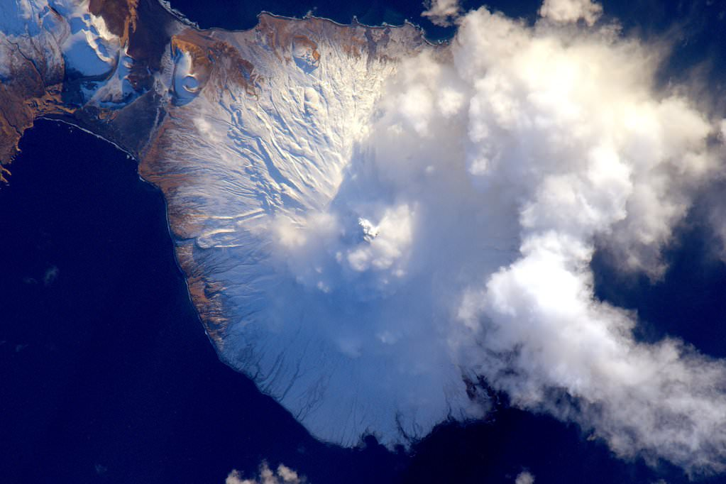Aleutian island #volcano letting off a little steam after the new year on Jan 2, 2016. #YearInSpace. Credit: NASA/Scott Kelly/@StationCDRKelly