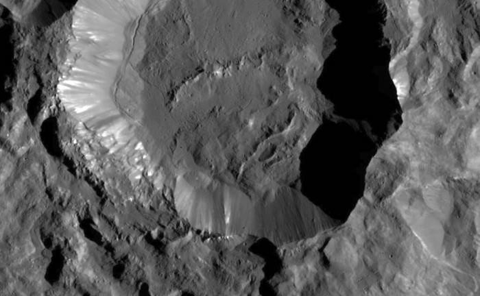 This image from NASA's Dawn spacecraft shows Kupalo Crater, one of the youngest craters on Ceres. The crater has bright material exposed on its rim and walls, which could be salts. Its flat floor likely formed from impact melt and debris.  Credits: NASA/JPL-Caltech/UCLA/MPS/DLR/IDA