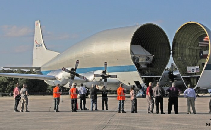 NASA's Orion EM-1 crew module pressure vessel arrived at the Kennedy Space Center's Shuttle Landing Facility tucked inside NASA's Super Guppy aircraft on Feb 1, 2016. The Super Guppy opens its hinged nose to unload cargo.  Credit: Ken Kremer/kenkremer.com