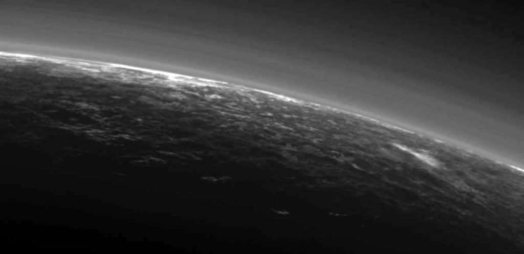 Recent images sent by NASA's New Horizons spacecraft show possible clouds floating over the frozen landscape including the streaky patch at right. Credit: NASA/JHUAPL/SwR